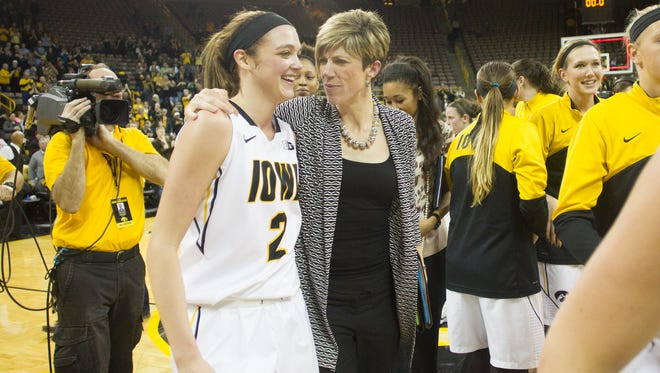 Iowa associate head coach Jan Jensen embraces Ally Disterhoft following their 78-72 overtime win over Nebraska at Carver-Hawkeye Arena on Monday. Disterhoft finished the game with 20 points and 13 rebounds after going scoreless in the first half.
