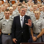 Jeb Bush stands with cadets at The Citadel after giving a speech on foreign policy last November at the school in Charleston, South Carolina.
