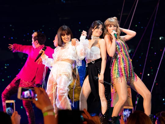 Charli XCX, left, Camila Cabello and Taylor Swift perform