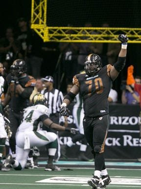 Rattlers defensive lineman Marcus Pittman celebrates a fumble  recovering against the SaberCats in last year's playoffs.