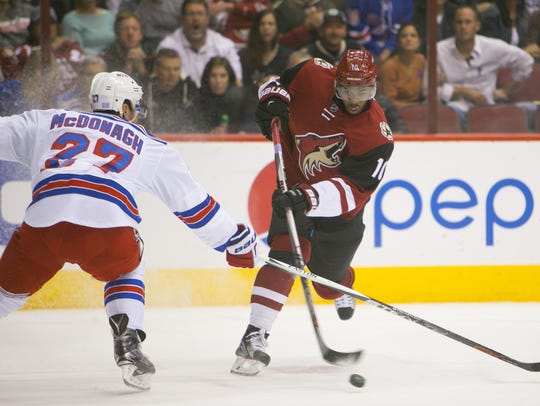 Arizona Coyotes' Anthony Duclair shoots by New York