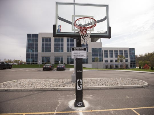 An adjustable basketball hoop waits for employees who