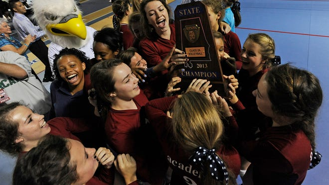 Montgomery Academy celebrates beating Providence Christian in the AHSAA Class 2A Volleyball Championship at the Crossplex in Birmingham, Ala. on Thursday October 31, 2013.(Mickey Welsh, Montgomery Advertiser)