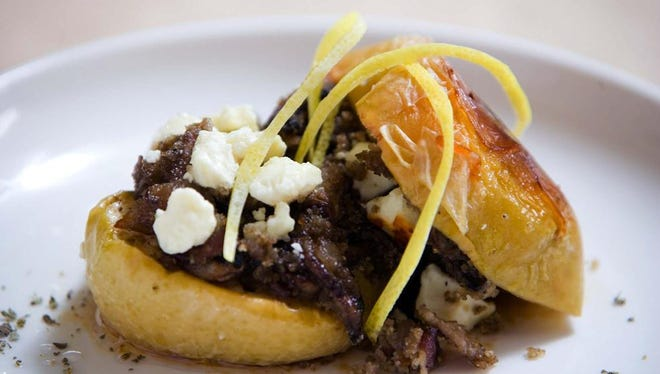 Maple-syrup-glazed apples are stuffed with bacon, onion, crimini mushrooms and feta cheese.