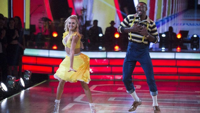 "Lindsay Arnold and Calvin Johnson, dressed as Steve Urkel, dance to the theme song of ""Family Matters"" during TV Night on ""Dancing with the Stars."""