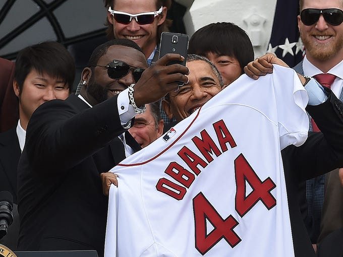 35a91c87bc0 Red Sox designated hitter David Ortiz takes a selfie with U.S. president  Barack Obama after presenting