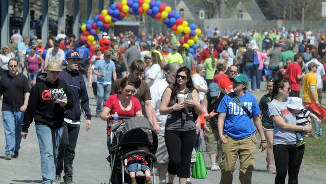 People walk around the track at the Dutchess County Fairgrounds in Rhinebeck, in this photo of the Hudson Valley Autism Society's 12th annual Autism Walk and Expo last year. This year's event was held on April 27.