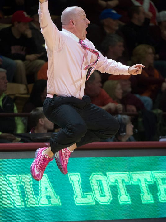 Virginia Tech coach Buzz Williams, wearing pink shoes, shirt and tie for breast cancer awareness, yells to his team during the second half of an NCAA college basketball game against Louisville on Wednesday, Jan. 27, 2016, in Blacksburg, Va. Louisville won 91-83. (AP Photo/Don Petersen)