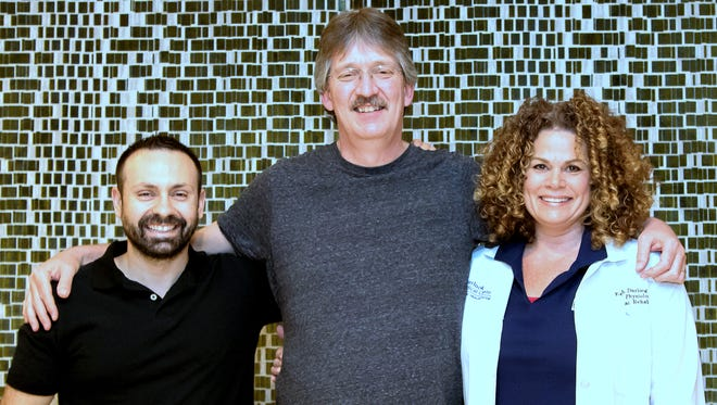 Waverly resident Jeff Seamans, center, joins clinical exercise physiologists Peter Toto and Sarah Darling at the Atlantic Health System/Chambers Center for Well Being in Morristown, New Jersey.