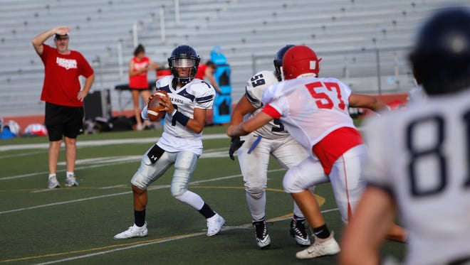 Piedra Vista quarterback Cameron Swarts drops back in the pocket and fires a pass down the right side against Durango during Friday's scrimmage at Hutchison Stadium. The Panthers open the 2018 season Friday at Los Lunas.