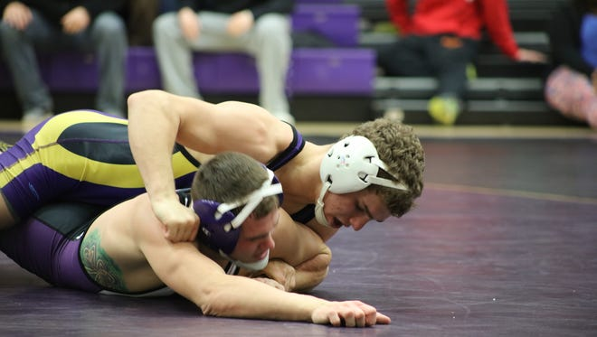 University of Wisconsin-Stevens Point sophomore Ben Vosters, a Wittenberg-Birnamwood graduate, attempts to turn UW-Whitewater's Logan Hanselmann in their 125-pound match Wednesday night. Vosters won a 7-5 decision to give the Pointers a 19-16 win over the No. 7 ranked Warhawks.