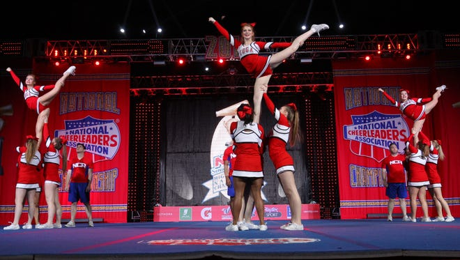 Tioga High cheerleaders perform a scale stunt at NCA nationals Jan. 23-24 in Dallas, Texas.