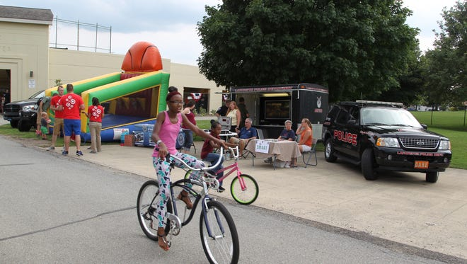 Children and families attend Lafayette's National Night Out event Tuesday outside Loeb Stadium at Columbian Park.