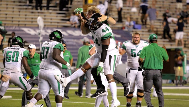 The North Texas Mean Green celebrate their 42-35 double overtime win over the Rice Owls at Rice Stadium. Mandatory Credit: Erik Williams-USA TODAY Sports