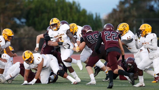 Hartnell's Sherrod Hawkes (5) breaks though MPC's defensive line during a college football game at Monterey Peninsula College on Saturday, November 5, 2016 in Monterey, Calif. -- Vernon McKnight/for The Californian
