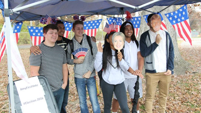 Jefferson High School students take photos on Election Day 2016 at the Tippecanoe County Fairgrounds.