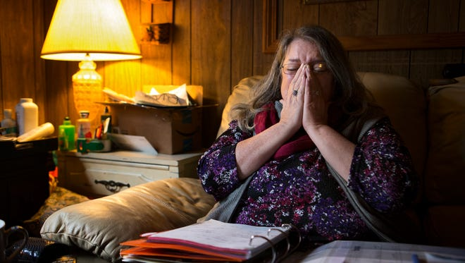 Debbie Childers cries after being turned down by a potential landlord for a home she was hoping to rent for her family. The Pleasant Ridge resident tracks the number of calls she's made in her binder. March 14, 2017