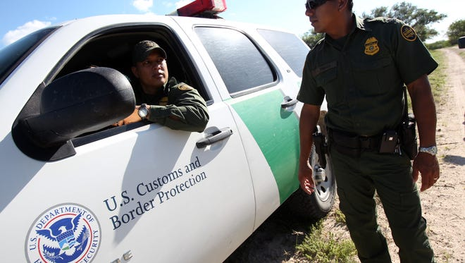 Michael Zamora/Caller-TimesBorder Patrol agents Horacio Espinoza (left) and Danny Tirado plan their next move Tuesday, June 4, 2013 as they try to catch up to a group of undocumented immigrants they suspect are making their way across a ranch in Brooks County, Texas.