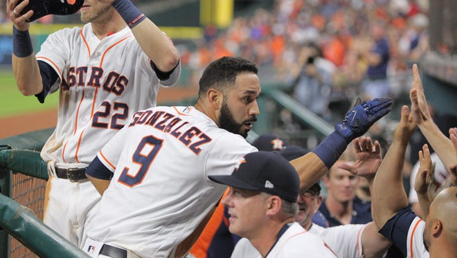 Houston Astros first baseman Marwin Gonzalez (9) is congratulated in the dugout after hitting a two-run home run against the Texas Rangers during the sixth inning at Minute Maid Park.