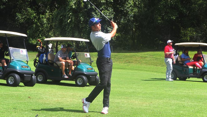 Professional golfer Trent Virden hits a shot at Riverview Golf & Country Club on Friday.