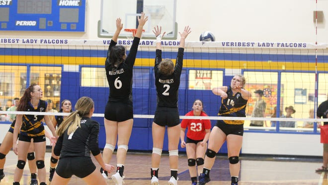 Water Valley's Caryson Sheppard (6) and Shelby Kolls (2) look to block a shot by Veribest's Kamryn Lindsey (14) during a District 7-2A match at the Veribest gym on Saturday, Oct. 7, 2017. Water Valley won the rematch Tuesday on its home court to complete a season sweep and successfully defend the District 7-2A title.