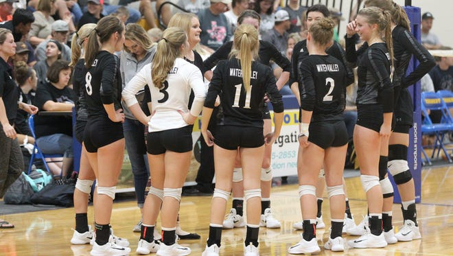 Water Valley head coach Lea Morris talks things over with the Lady Wildcats during a District 7-2A match at the Veribest gym on Saturday, Oct. 7, 2017.