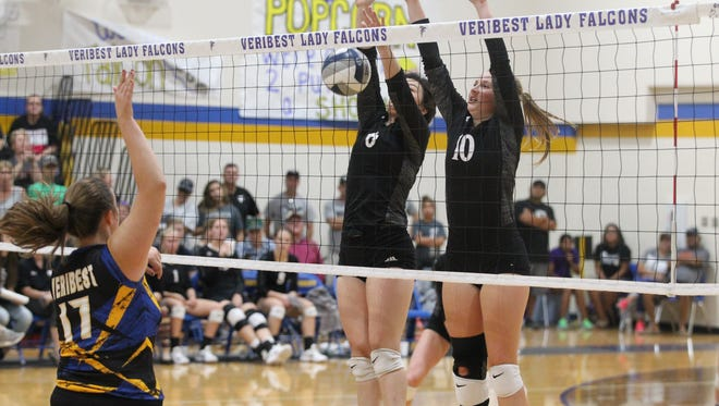 Veribest's Abby Taylor (17) knocks down a shot against Water Valley's Carysn Sheppard and Chesney Baker during a District 7-2A match at the Veribest gym on Saturday, Oct. 7, 2017.