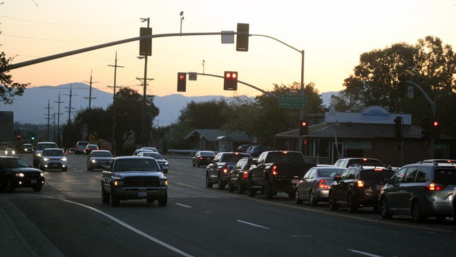 Early morning traffic backs up Friday morning on eastbound Eureka Way as parents dropping off their kids at Shasta High School wait to turn left onto Pioneer Drive.