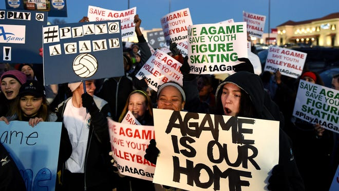 Volleyball player Hollie Haynie,16,right, protest with others on closing of A-Game Sportsplex in a parking lot Cool Springs Galleria before marching to A-Game in Franklin, Tenn on Thursday Feb. 4, 2016.