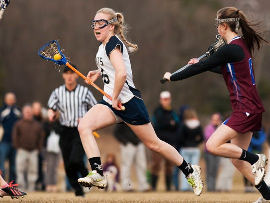 Essex's Mady Corkum (16) runs down the field with the