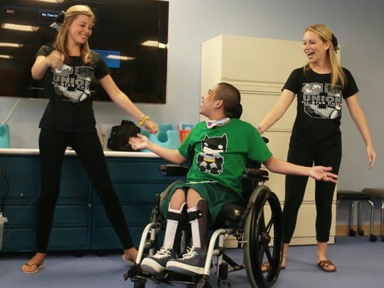 Snapple Bowl Union County cheerleaders, Drew Ferriss (cq), left, and Katie Clark, both from Westfield High School cheer with Joffre, a long-term resident at Children's Specialized Hospital, during a visit in Mountainside on July 18, 2016.