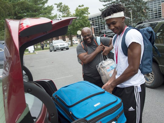 Montrel Morgan and his father, Montez Parker, unpack their car at East Stroudsburg University on move-in day. Montrel will study aerospace engineering and play basketball. Father and son weren't close at the beginning of Montrel's life, but they've made up for that time. A former William Penn football player raised by his mother, Montez Parker has mentored and coached York kids in basketball and football for many years.