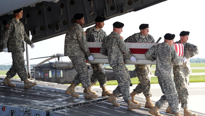 Secretary of the Army John M McHugh and the son and daughter of of Army Maj. General Harold J. Greene were present as his remains returned to U.S. soil Thursday morning.  He was killed serving in Operation Enduring Freedom in Afghanistan.
