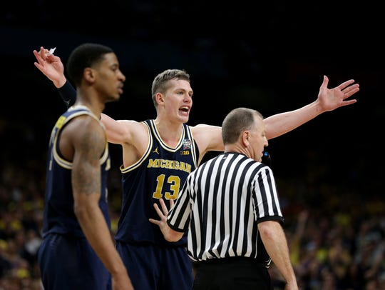 Michigan forward Moritz Wagner reacts after he was