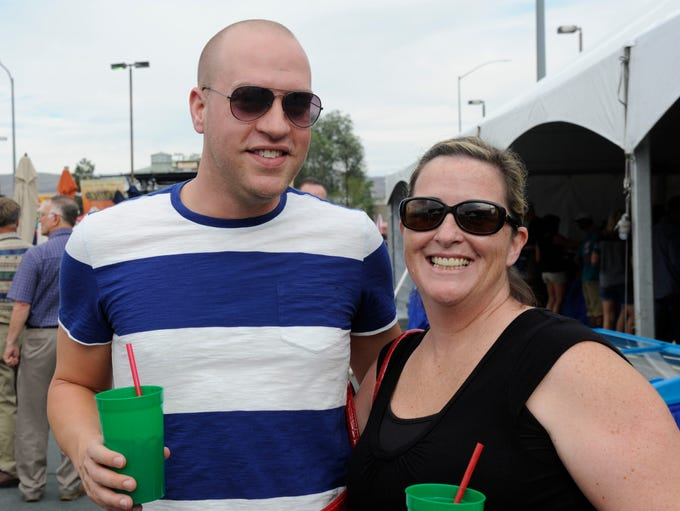 Daniel Morley, left, and Becky Bailey attend the 26th annual Best in the West Nugget Rib Cook-off while inside the Rib Village Friday Aug. 29, 2014.