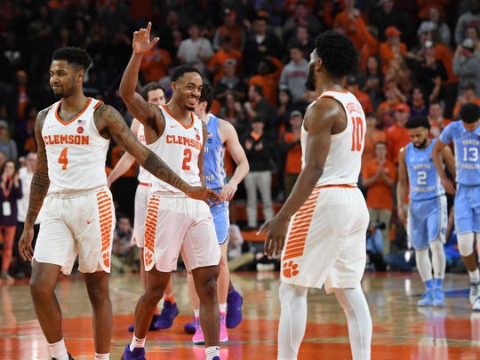 From left, Clemson guards Shelton Mitchell (4), Marcquise Reed (2), and Gabe DeVoe (10) during the closing seconds of the Tigers win over North Carolina on Tuesday, January 30,  2018, at Clemson's Littlejohn Coliseum.