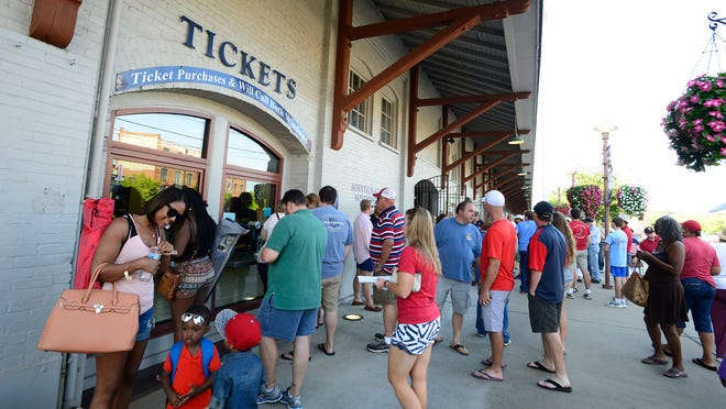Fans buy tickets for the Montgomery Biscuits Mississippi Braves game at Riverwalk Stadium in Montgomery, Ala. on Friday July 4, 2014.