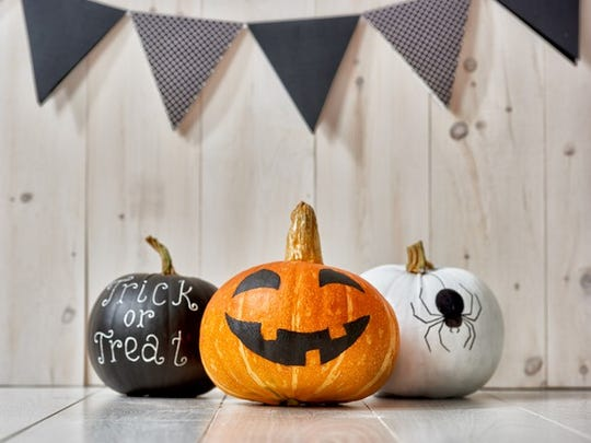 Three decorated pumpkins