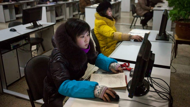 North Koreans work at computer terminals inside the Grand People's Study House in Pyongyang in January 2013.
