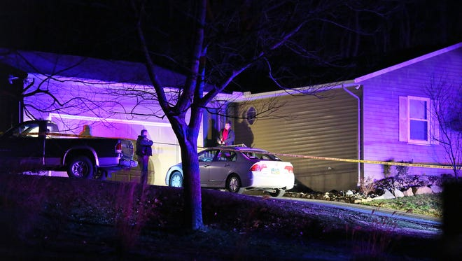 Deputies respond to the scene of a double shooting Thursday night on Price Road. The Bureau of Criminal Investigation was called to the scene.