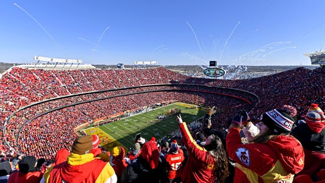 Kansas City Chiefs fans cheer as fireworks are shot off prior to the AFC Championship game at Arrowhead Stadium. Stadiums like Arrowhead may not feature fully packed crowds in the future because of the coronavirus pandemic.