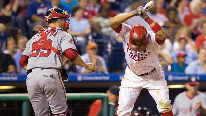 Phillies third baseman Andres Blanco slams his bat to the ground in front of Washington Nationals catcher Jose Lobaton after striking out to end the fifth inning Wednesday at Citizens Bank Park in Philadelphia.