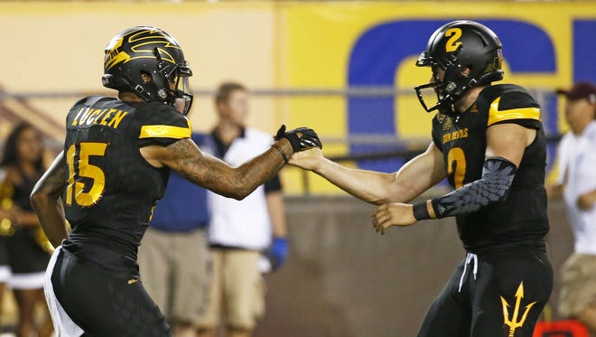 ASU's Devin Lucien and quarterback Mike Bercovici celebrate their touchdown pass play against Colorado at Sun Devil Stadium in the second half on Oct. 10, 2015 in Tempe, AZ.