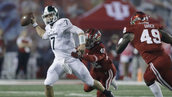 Michigan State quarterback Tyler O'Connor  is pressured by Indiana defensive back Marcelino Ball during Saturday night's matchup in Bloomington, Ind.