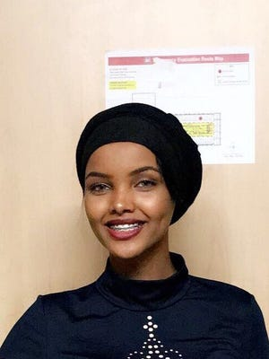 In this Nov. 11, 2016, photo provided by Alishba Kazmi, Halima Aden poses for a photo at St. Cloud State University. Aden, a Somali-American, will be the first to compete in the Miss Minnesota USA contest while wearing a hijab and other modest Muslim clothing that keeps her fully covered.