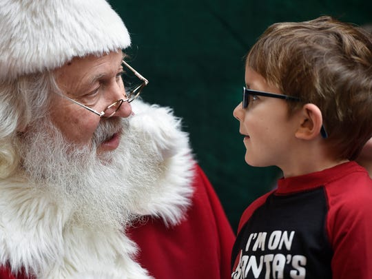 Ben Kimman shares his Christmas list with Santa Bob Hutton Dec. 23, 2016, at Crossroads Center in St. Cloud.
