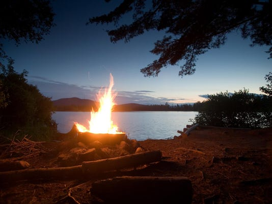 Campfire on shore of lake