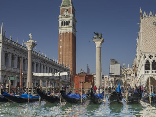 A view of St. Mark's Square in Venice. Italy is the top tourist destination this fall and holiday season, according to International luxury travel network Virtuoso. The Rialto Bridge in Venice is shown above.