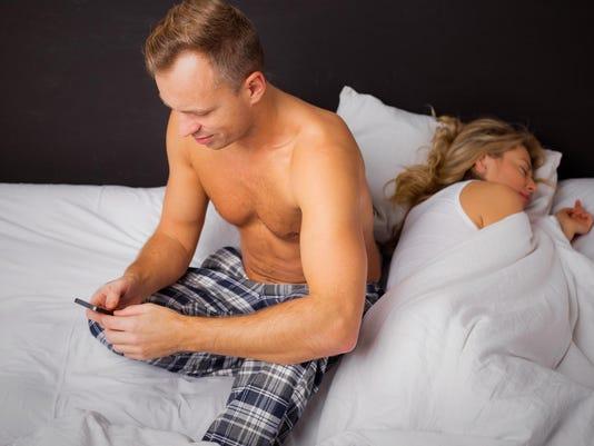 Woman sleeping and man texting