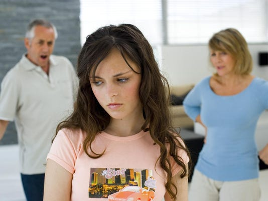 Daughter with her unhappy parents